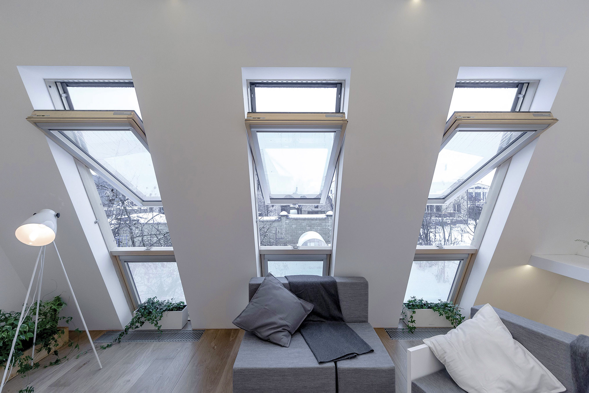 Opened high pivot roof windows in living room