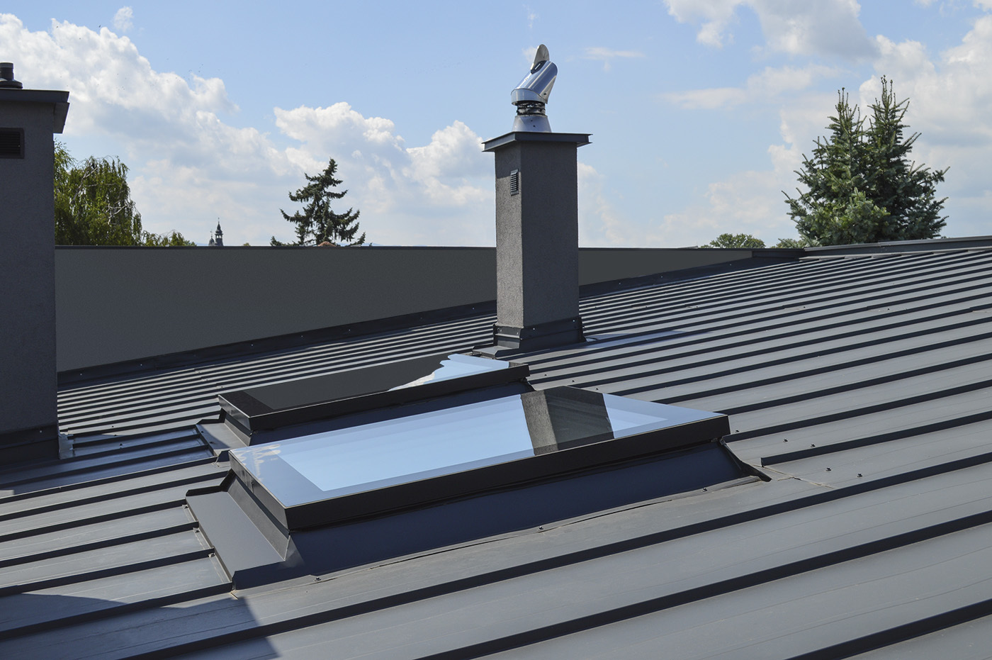 Closed flat roof window on roof