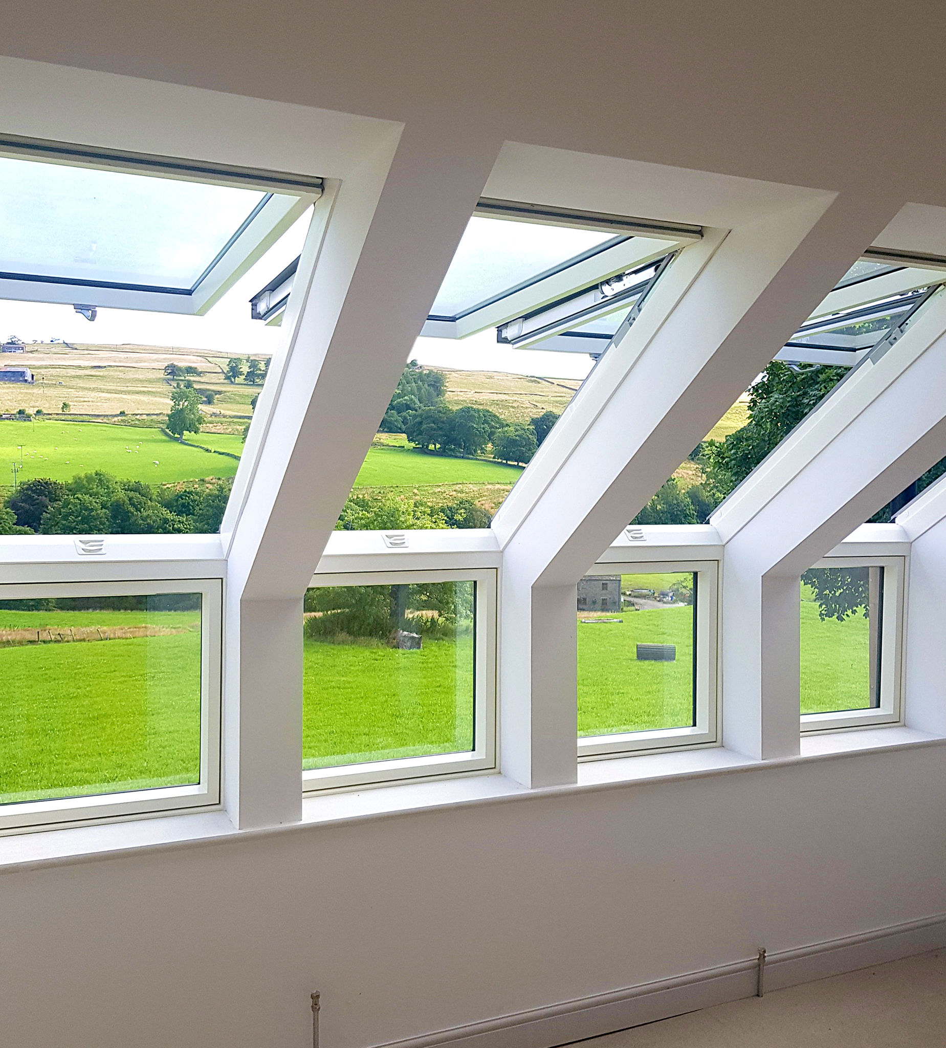 Open roof windows revealing countryside