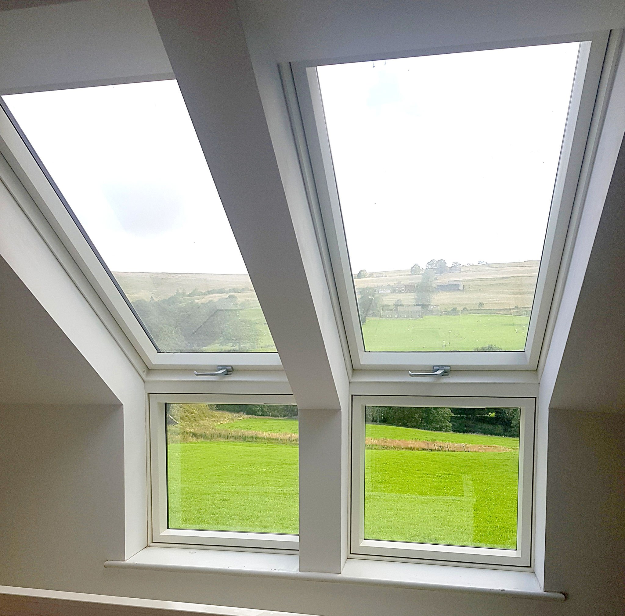 Roof windows revealing view of countryside