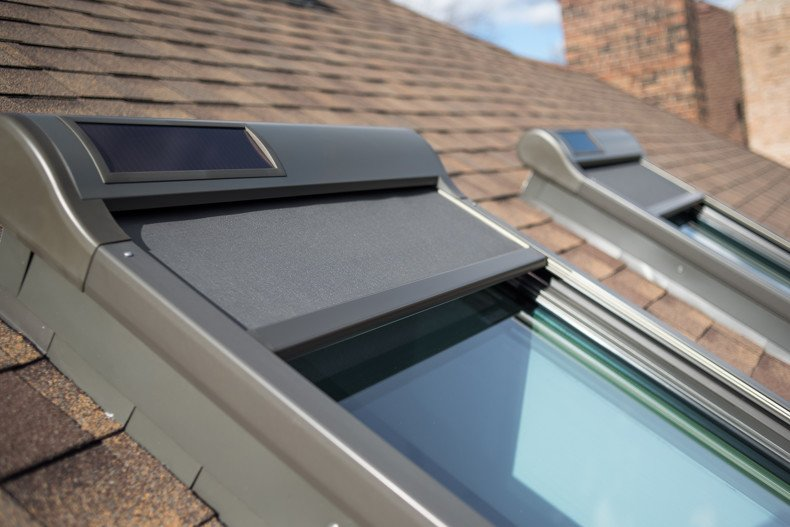 Solar awning blinds on roof window